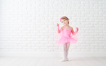 50766538 - little child girl dreams of becoming ballerina in a pink tutu skirt